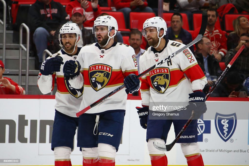 Vincent Trocheck #21 of the Florida Panthers (L) celebrates his third period goal with Keith Yandle #3 and Aaron Ekblad #5 while playing the Detroit Red Wings at Little Caesars Arena on December 11, 2017 in Detroit, Michigan. Florida won the game 2-1 in overtime.