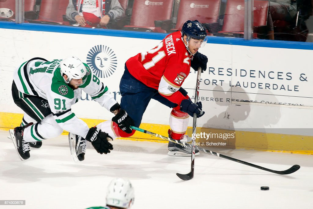 Vincent Trocheck #21 of the Florida Panthers crosses sticks with Tyler Seguin #91 of the Dallas Stars in overtime at the BB&T Center on November 14, 2017 in Sunrise, Florida.