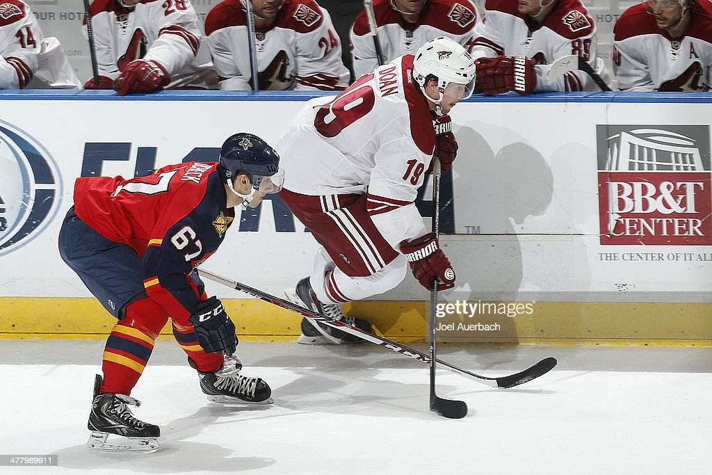 Vincent Trocheck #67 of the Florida Panthers defends against Shane Doan #19 of the Phoenix Coyotes as he skates up ice in the third period at the BB&T Center on March 11, 2014 in Sunrise, Florida. The Coyotes defeated the Panthers 3-1.