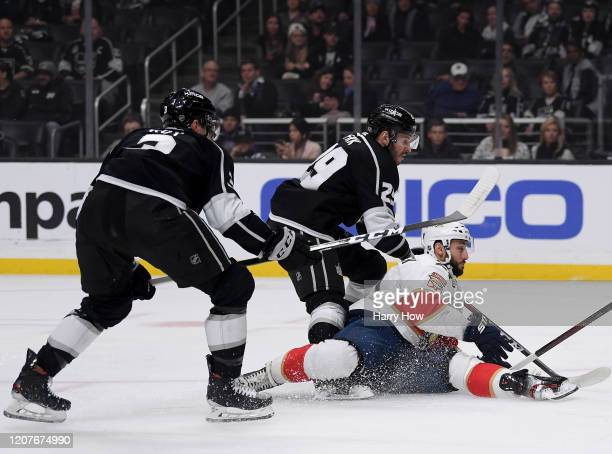 Vincent Trocheck of the Florida Panthers falls between Martin Frk and Matt Roy during the first period at Staples Center on February 20 2020 in Los...