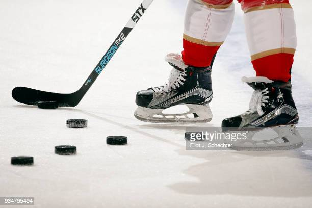 Vincent Trocheck of the Florida Panthers feeds practice pucks to teammates during warm ups against the Edmonton Oilers at the BBT Center on March 17...