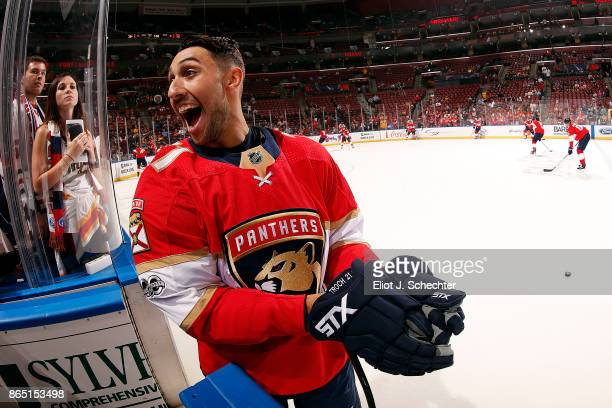 Vincent Trocheck of the Florida Panthers has a laugh during warm ups against the Pittsburgh Penguins at the BBT Center on October 20 2017 in Sunrise...
