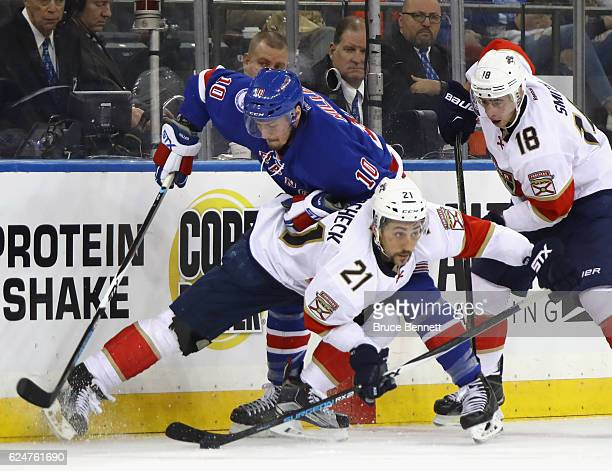 Vincent Trocheck of the Florida Panthers is tripped up by JT Miller of the New York Rangers during the third period at Madison Square Garden on...