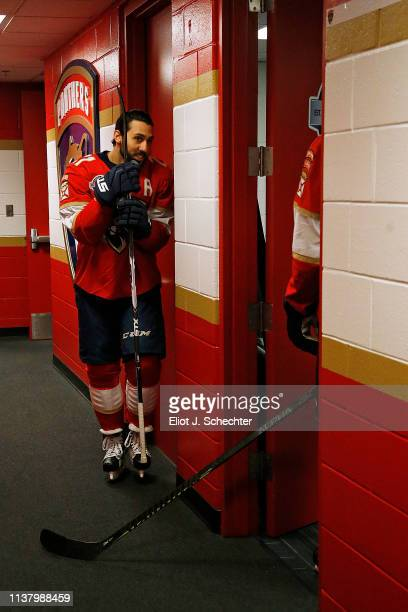 Vincent Trocheck of the Florida Panthers plays a little hide and seek with teammate Aleksander Barkov in the hallway prior to heading out to the ice...