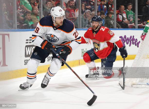 Vincent Trocheck of the Florida Panthers recovers after being knocked to the ice by Leon Draisaitl of the Edmonton Oilers at the BBT Center on March...