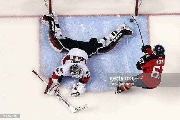 Vincent Trocheck of the Florida Panthers scores against goaltender Robin Lehner of the Ottawa Senators in a shoot out at the BBT Center on March 25...