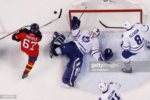 Vincent Trocheck of the Florida Panthers skates after the puck after Goaltender Drew MacIntyre of the Toronto Maple Leafs makes a save in the second...