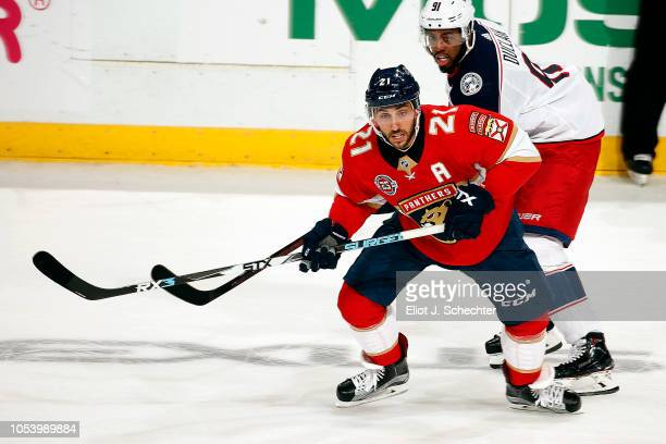 Vincent Trocheck of the Florida Panthers skates for position against Anthony Duclair of the Columbus Blue Jackets at the BBT Center on October 11...