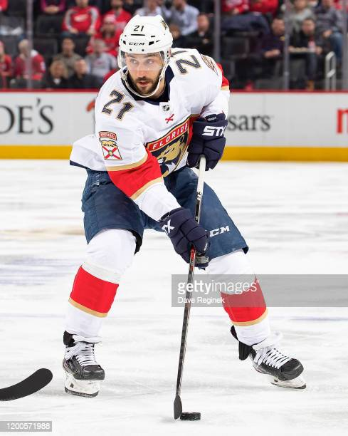 Vincent Trocheck of the Florida Panthers skates up ice with the puck against the Detroit Red Wings during an NHL game at Little Caesars Arena on...