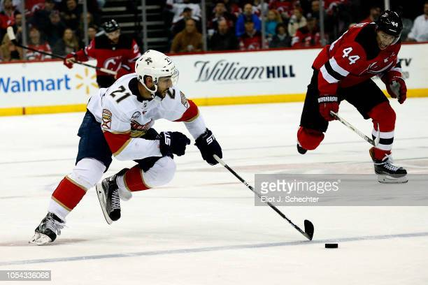 Vincent Trocheck of the Florida Panthers skates with the puck against the New Jersey Devils at the Prudential Center on October 27 2018 in Newark New...