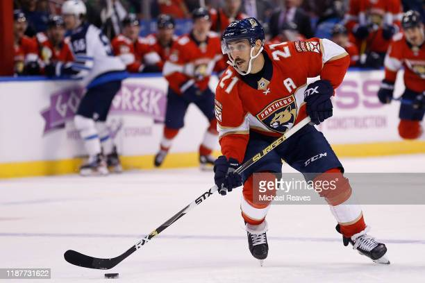 Vincent Trocheck of the Florida Panthers skates with the puck against the Winnipeg Jets during the third period at BBT Center on November 14 2019 in...