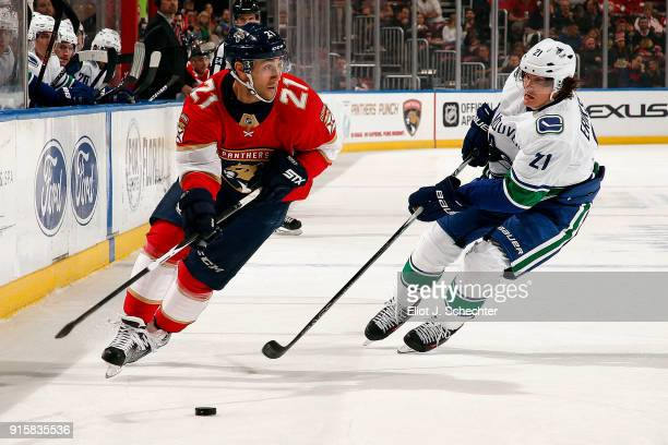 Vincent Trocheck of the Florida Panthers skates with the puck against Loui Eriksson of the Vancouver Canucks at the BBT Center on February 6 2018 in...