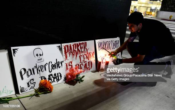 Vincent Vicencio lights a candle during a housing and homeless advocates funeral procession and Candlelight March to mourn the destruction of the...