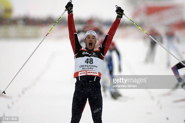 Vincent Vittoz of France celebrates crossing the finish Line of Cross Country men's 20 km classical and free pursuit race in Oberstdorf, 02 January...