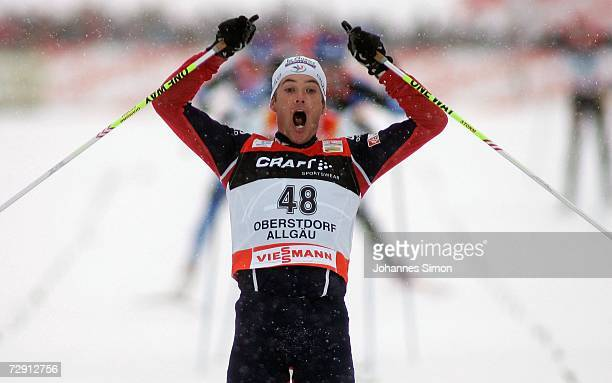 Vincent Vittoz of France celebrates crossing the finish Line of the men's Cross Country 20 km classical and free pursuit race on 02, January 2007 in...