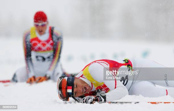 Vincent Vittoz of France falls to the snow after completing the Mens Cross Country Skiing 15km Interval Start Final on Day 7 of the 2006 Turin Winter...
