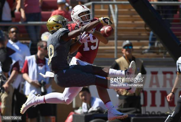 Vincent White of the UC Davis Aggies breaks up the pass in the endzone to JJ ArcegaWhiteside of the Stanford Cardinal during the second quarter of an...