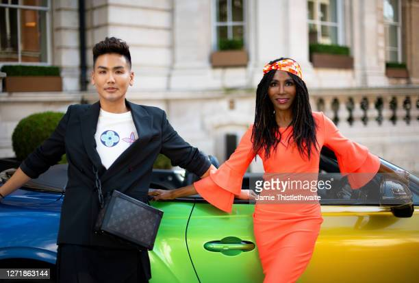 """Vincent Wong and Sinitta pose with the rainbow Bentley during the """"Henpire"""" podcast launch event at Langham Hotel on September 10, 2020 in London,..."""