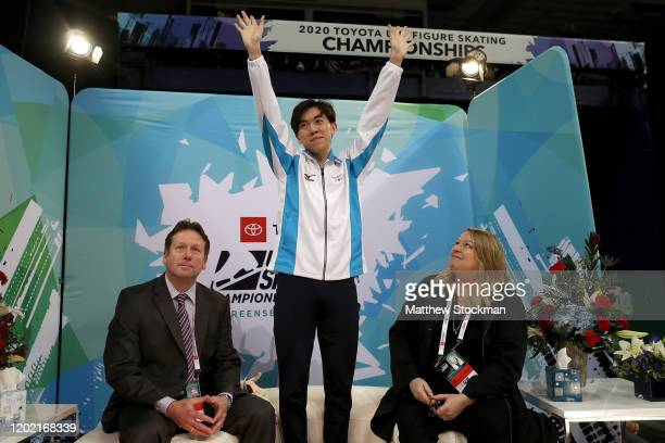 Vincent Zhou reacts with his coaches Lee Barkell and Lori Nichol to his scores after skating in the Men's Free Skate during the 2020 US Figure...