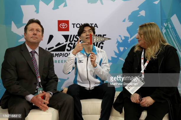 Vincent Zhou waits with his coaches Lee Barkell and Lori Nichol for his socres afte skating in the Men's Free Skate during the 2020 US Figure Skating...