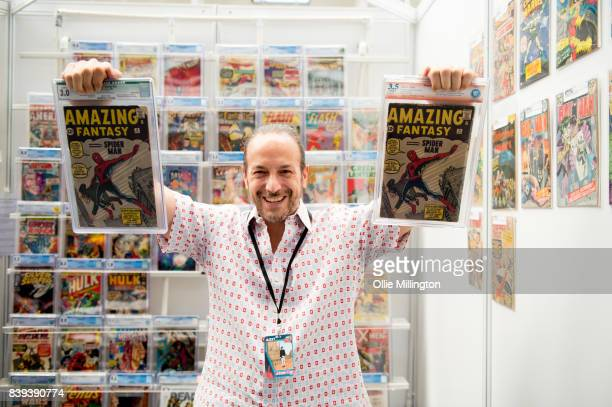 Vincent Zurzolo of Metropolis Collectables poses with two issues of Amazing Fantasy issue 15. PublishedÊAugust 10, 1962 Writen byÊStan LeeÊand...