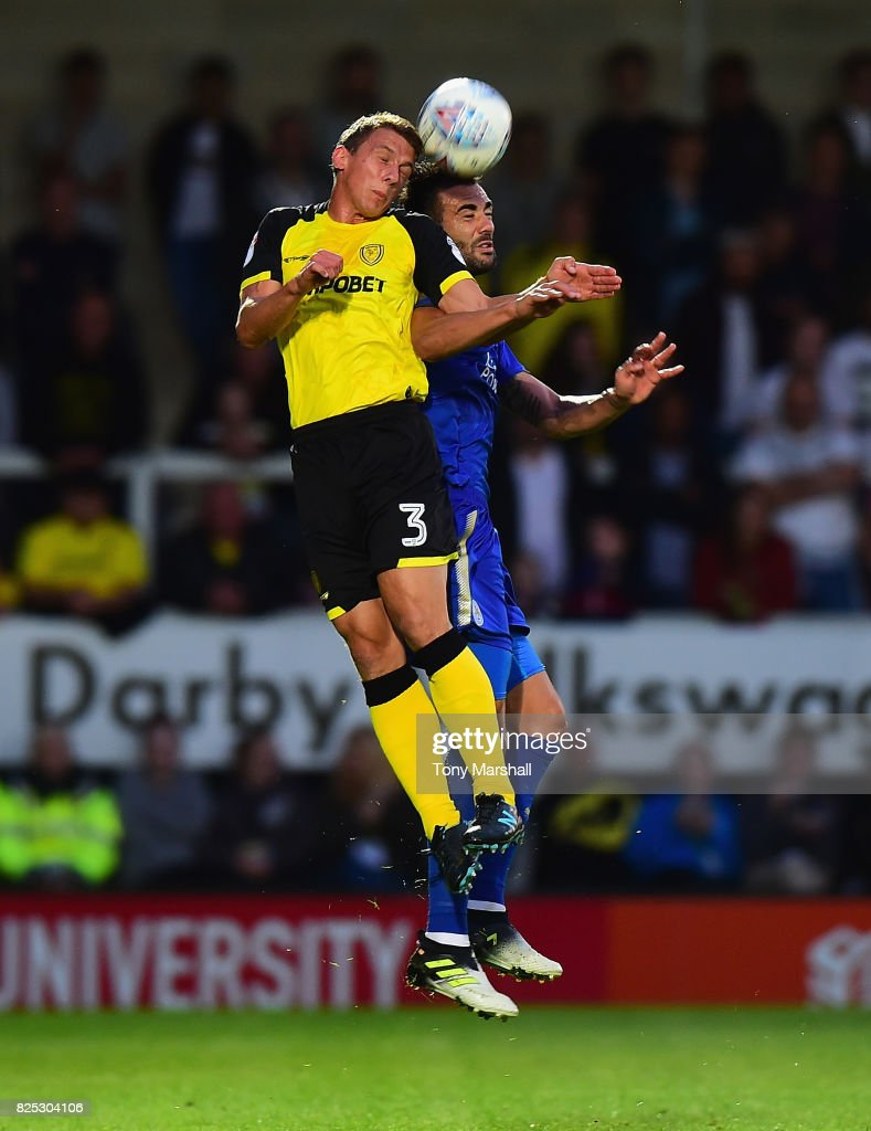 Vincente Iborra of Leicester City challenges Stephen Warnock of Burton Albion during the Pre-Season Friendly match between Burton Albion v Leicester City at Pirelli Stadium on August 1, 2017 in Burton-upon-Trent, England.