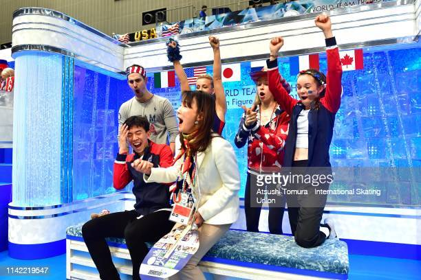 VincentZhou of the United States celebrates his score at the kiss and cry with his team mates after competing in the Men's Single Free Skating on...