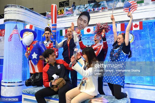 VincentZhou of the United States celebrates his score with his team mates at the kiss and cry after competing in the Men's Single Short Program on...