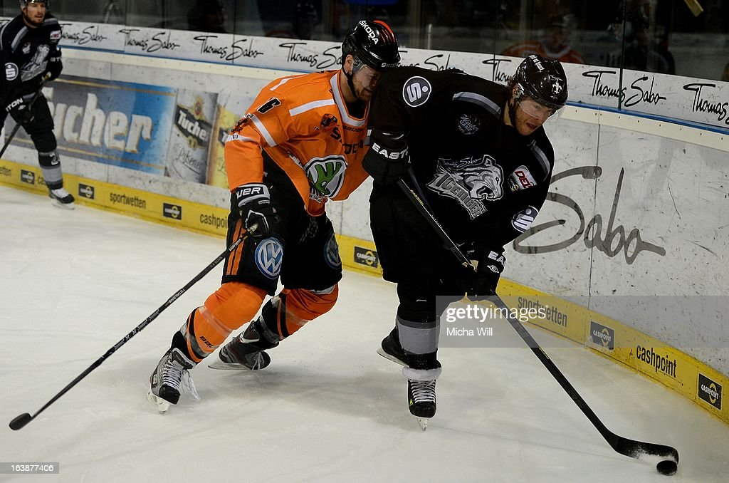 Vincenz Mayer (L) of Wolfsburg challenges Yan Stastny of Nuremberg during game three of the DEL pre-play-offs between Thomas Sabo Ice Tigers and Grizzly Adams Wolfsburg on March 17, 2013 in Nuremberg, Germany.