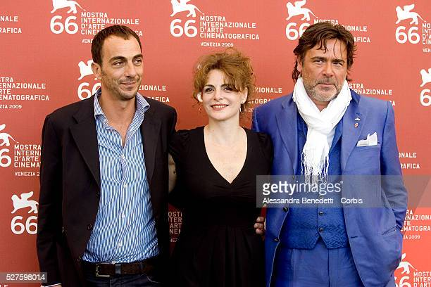 "Vincenzo and Caterina Varzi with Alberto Patrolini and director Tinto Brass attend the photocall of the short film ""Hotel Courbet"" during the 66th..."