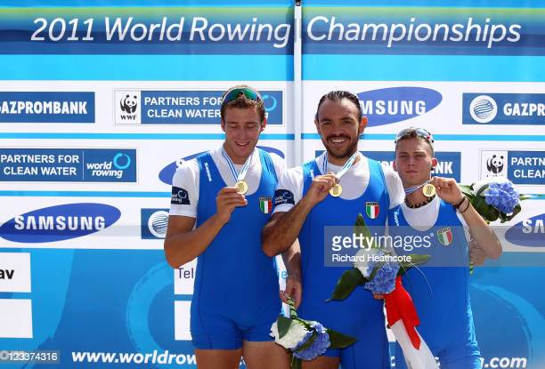 Vincenzo Capelli Pierpaolo Frattini and Niccolo Fanchi of Italy celebrate with their gold medals after winning the Men's Coxed Pair final during day...
