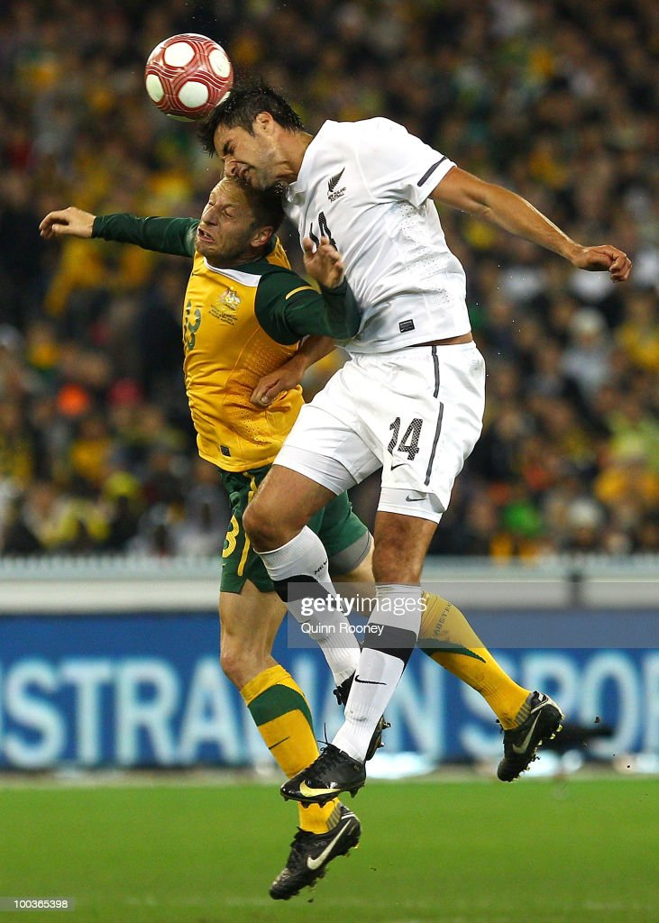 Vincenzo Grella of Australia and Rory Fallon of New Zealand contest to head the ball during the 2010 FIFA World Cup Pre-Tournament match between the Australian Socceroos and the New Zealand All Whites at Melbourne Cricket Ground on May 24, 2010 in Melbourne, Australia.