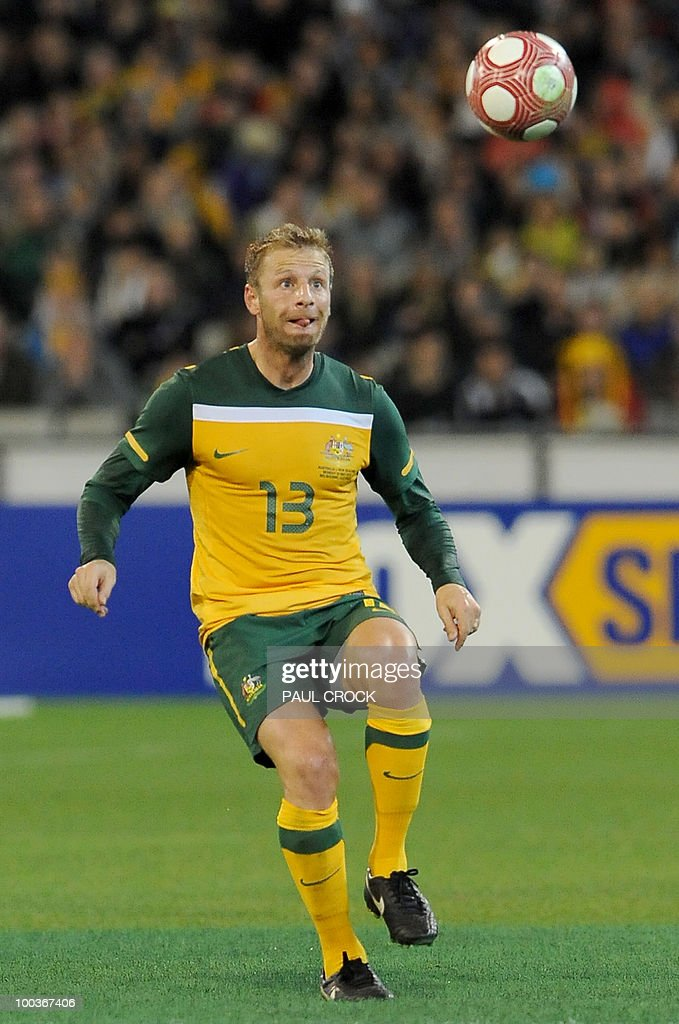 Vincenzo Grella of Australia keeps his eye on the ball during their friendly international football match against New Zealand in Melbourne on May 24, 2010. Australia won the match 2-1. RESTRICTED
