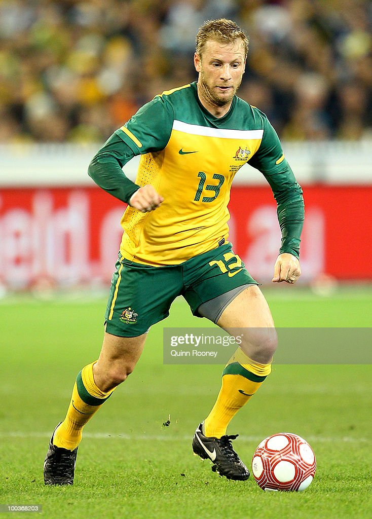 Vincenzo Grella of Australia passes the ball during the 2010 FIFA World Cup Pre-Tournament match between the Australian Socceroos and the New Zealand All Whites at Melbourne Cricket Ground on May 24, 2010 in Melbourne, Australia.