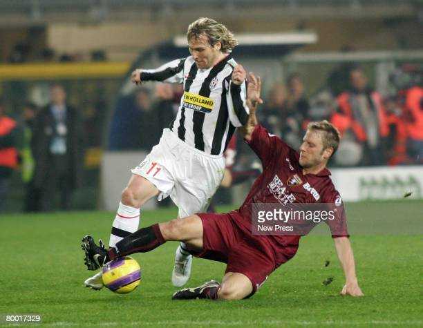 Vincenzo Grella of Torino clashes with Pavel Nedved of Juventus during the Serie A match between Torino and Juventus at the Stadio Olimpico on...