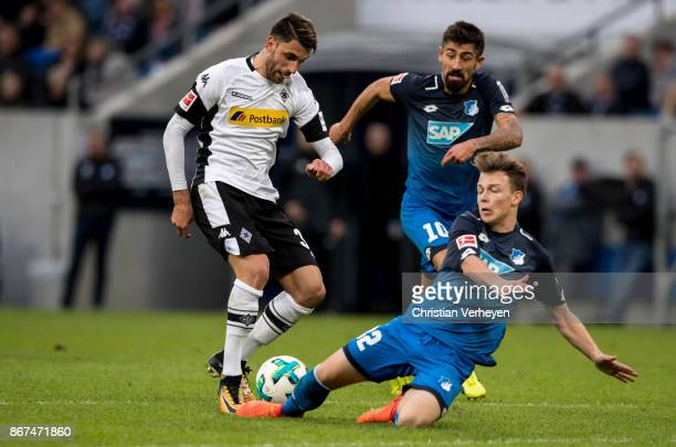 Vincenzo Grifo of Borussia Moenchengladbach and Dennis Geiger of 1899 Hoffenheim battle for the ball during the Bundesliga match between TSG1899...