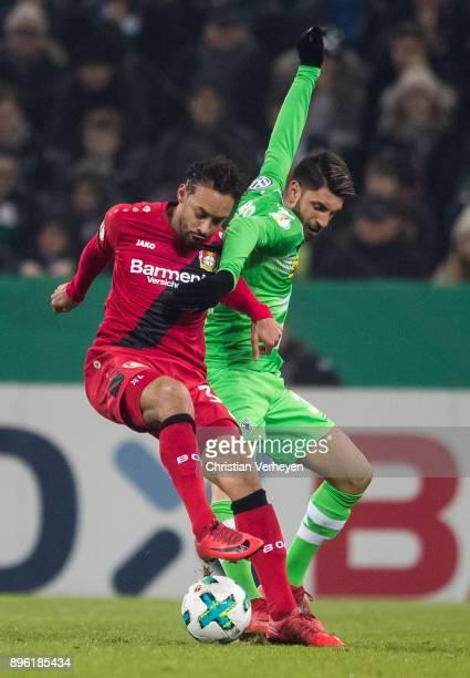 Vincenzo Grifo of Borussia Moenchengladbach and Karim Bellarabi of Bayer 04 Leverkusen battle for the ball during the DFBCup match between Borussia...