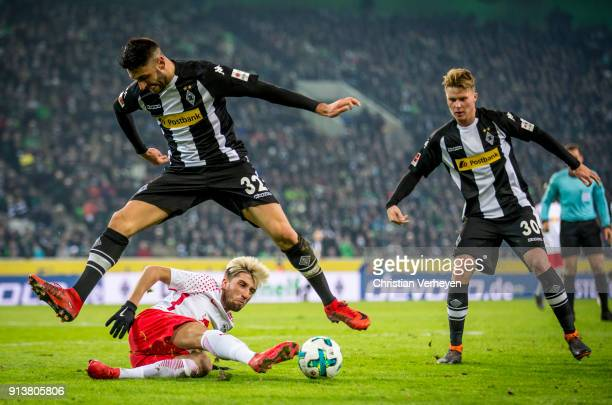 Vincenzo Grifo of Borussia Moenchengladbach and Kevin Kampl of RB Leipzig battle for the ball during the Bundesliga match between Borussia...