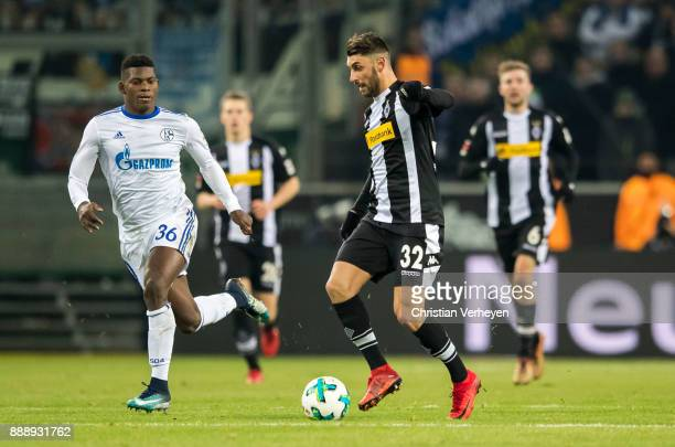 Vincenzo Grifo of Borussia Moenchengladbach is chased by Breel Embolo of FC Schalke 04 during the Bundesliga match between Borussia Moenchengladbach...