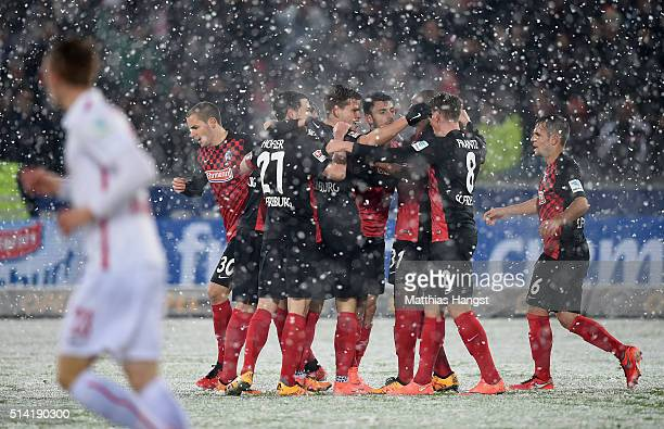 Vincenzo Grifo of Freiburg celebrates with his teammates after scoring his team's first goal during the Second Bundesliga match between SC Freiburg...
