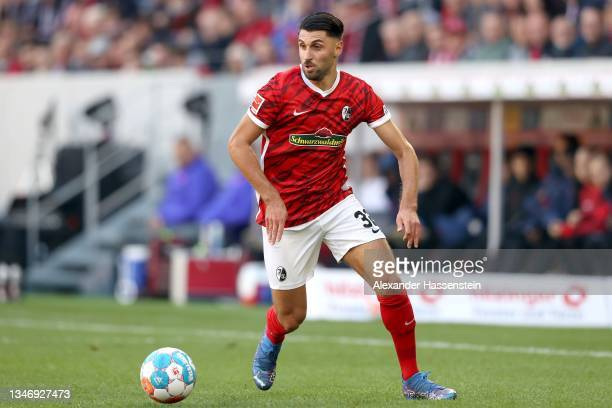 Vincenzo Grifo of Freiburg runs with the ball during the Bundesliga match between Sport-Club Freiburg and RB Leipzig at SC-Stadion on October 16,...