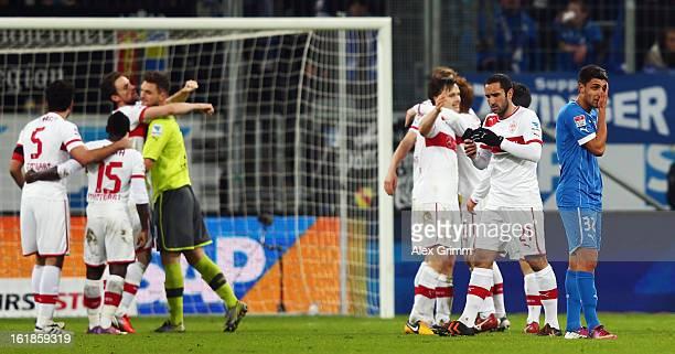 Vincenzo Grifo of Hoffenheim reacts as players of Stuttgart celebrate after the Bundesliga match between TSG 1899 Hoffenheim and VfB Stuttgart at...