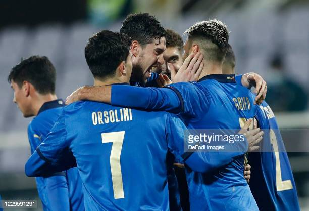 Vincenzo Grifo of Italy celebrates after scoring his team's third goal with team mates during the International Friendly match between Italy and...