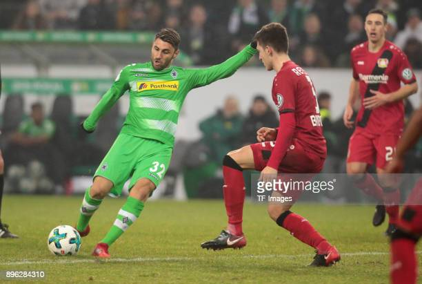 Vincenzo Grifo of Moenchengladbach and Panagiotis Retsos of Leverkusen battle for the ball during the DFB Cup match between Borussia Moenchengladbach...