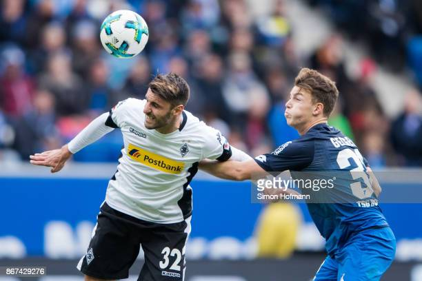 Vincenzo Grifo of Moenchengladbach is challenged by Dennis Geiger of Hoffenheim during the Bundesliga match between TSG 1899 Hoffenheim and Borussia...
