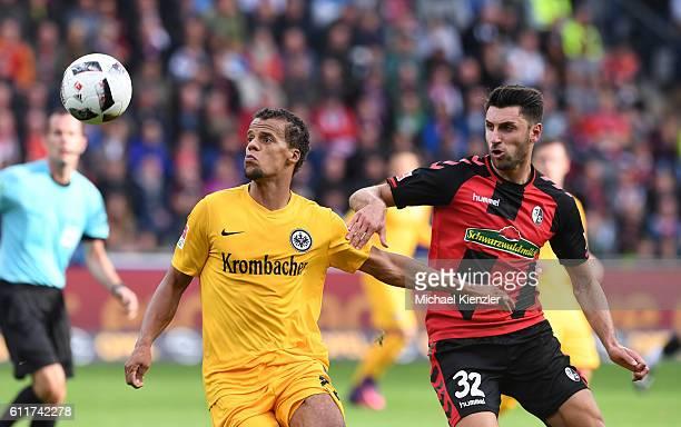 Vincenzo Grifo of SC Freiburg challenges Timothy Chandler of Eintracht Frankfurt during the Bundesliga match between Sport Club Freiburg and...