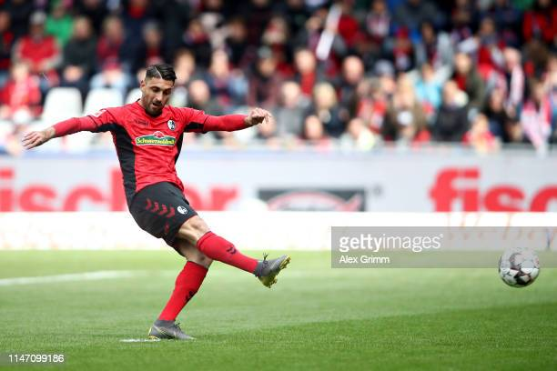 Vincenzo Grifo of Sport-Club Freiburg scores the opening goal from the penalty spot during the Bundesliga match between Sport-Club Freiburg and...