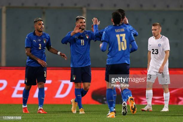 Vincenzo Grifo with his teammates of Italy celebrates after scoring the opening goal during the international friendly match between Italy and...