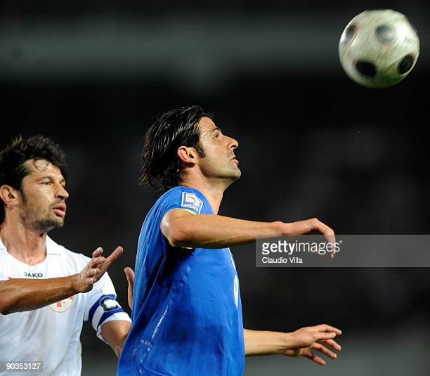 Vincenzo Iaquinta of Italy and Kakha Kaladze during the FIFA 2010 World Cup Qualifier match between Georgia and Italy at Boris Paichadze National...