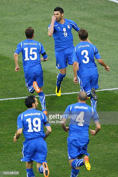 Vincenzo Iaquinta of Italy celebrates scoring the first goal for his team from the penalty spot with Domenico Criscito Claudio Marchisio Gianluca...